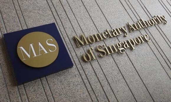 Singapore central bank eases monetary policy in unexpected move